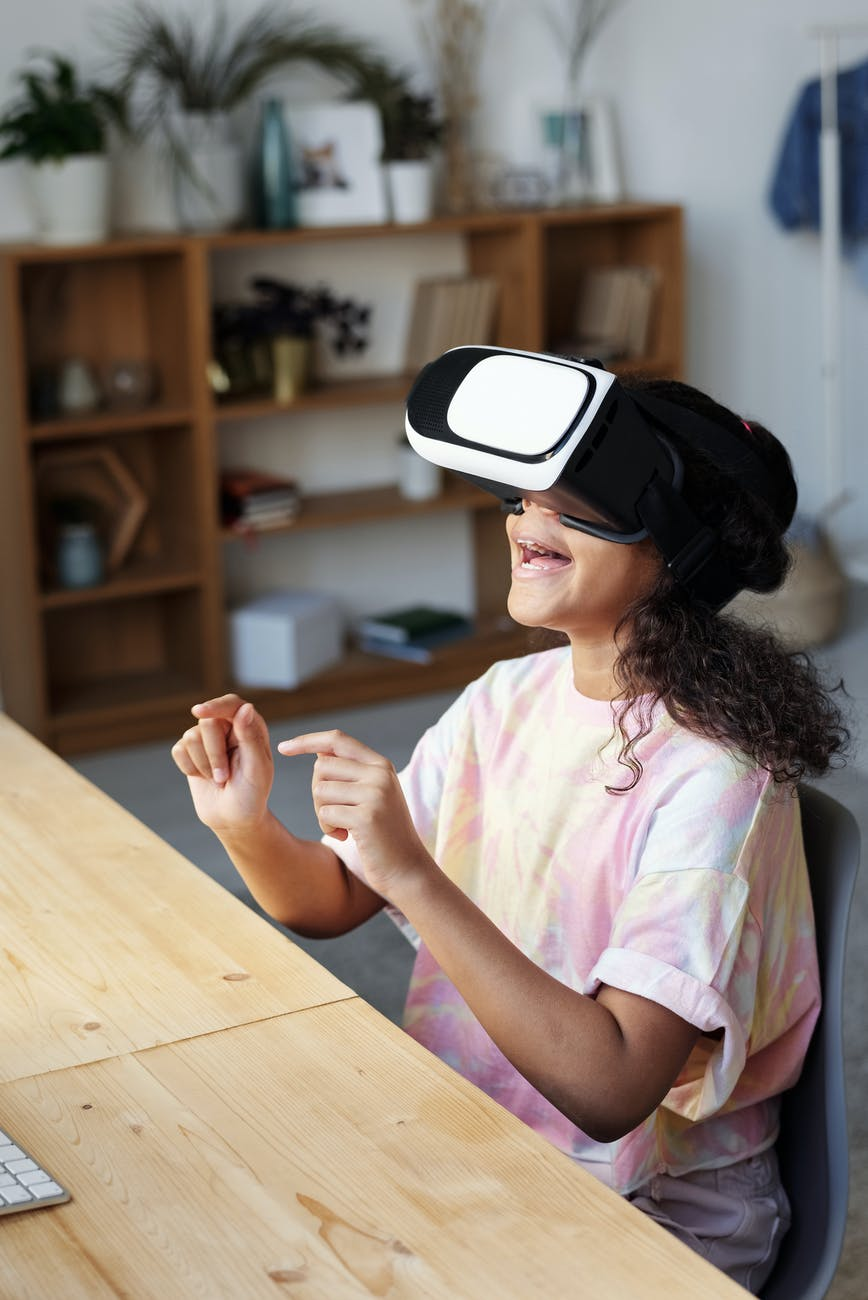photo of girl using vr headset